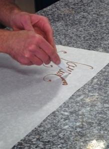 chocolat écriture avec le cone